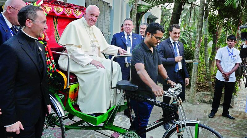 Pope Franchis ride the rickshaw when traveling Dhaka