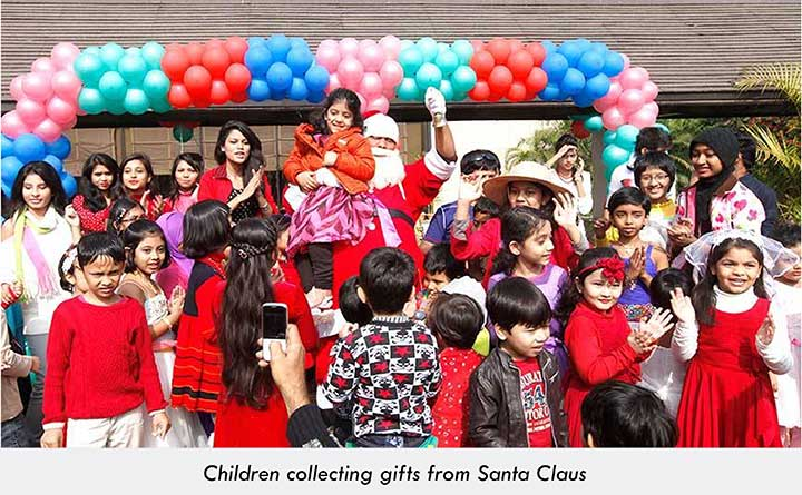 Christian children receiving gifts from Santa Claus