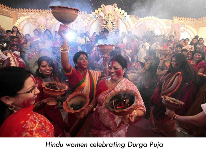 Hindu women celebrating Durga Puja
