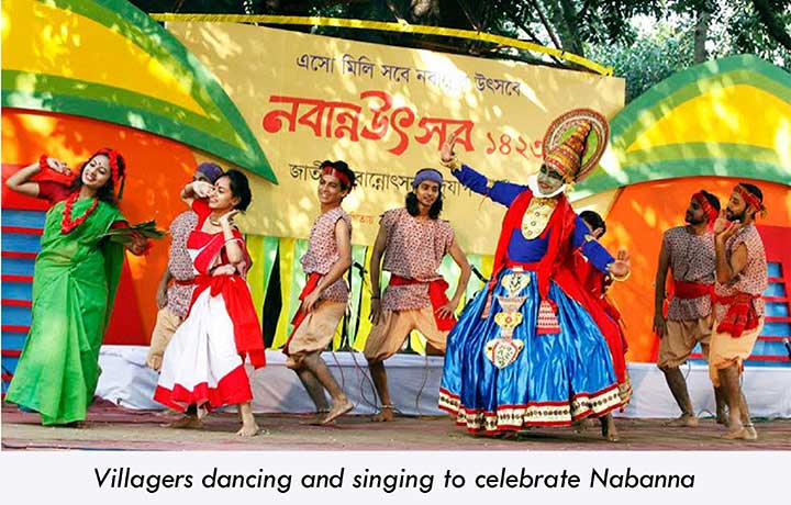 Villagers singing and dancing in Nabanna