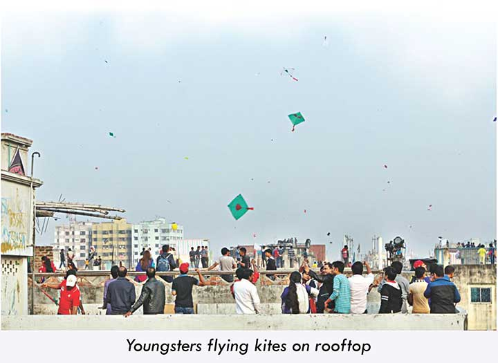 People flying kites on rooftop